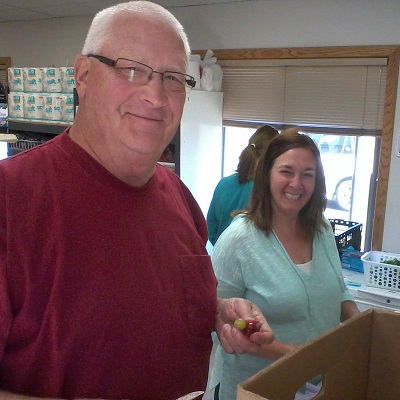 Food Pantry workers smile for the camera.