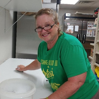 Jean cleaning food pantry.